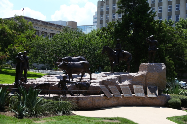 There are tons of statues all over the front lawn that brings to life Texas's history